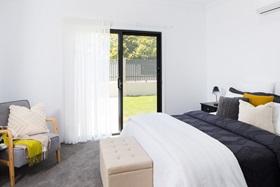 Protec sliding security screen door in bedroom